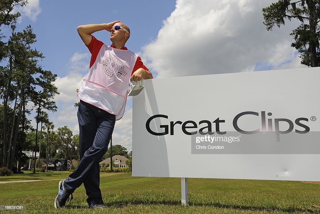 Ben Crane poses with a sponsor sign on the first hole of the PGA TOUR Wives Classic golf tournament held on Dye's Valley course before THE PLAYERS Championship on THE PLAYERS Stadium Course at TPC Sawgrass on May 7, 2013 in Ponte Vedra Beach, Florida.
