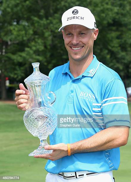 Ben Crane poses with the trophy after finishing as champion after the final round of the FedEx St Jude Classic at the TPC Southwind on June 8 2014 in...