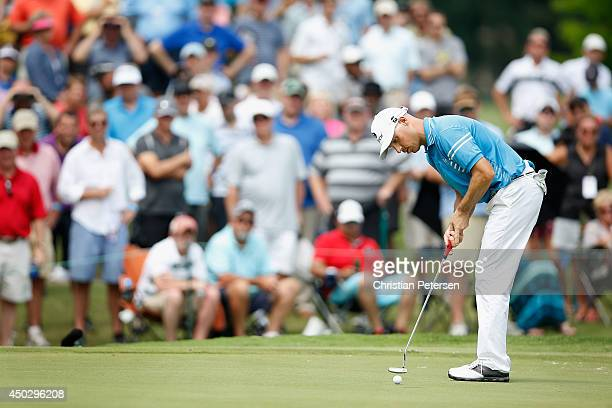Ben Crane putts on the 17th green during the final round of the FedEx St Jude Classic at the TPC Southwind on June 8 2014 in Memphis Tennessee