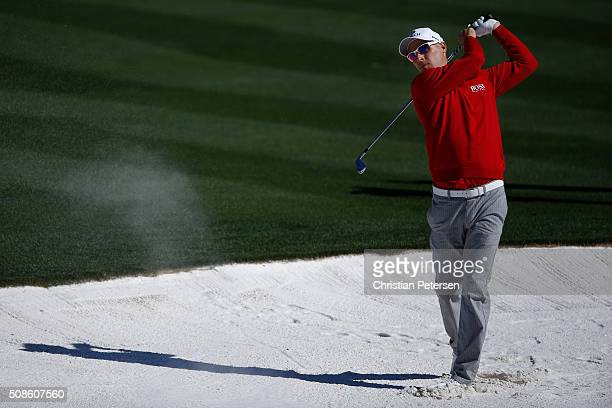 Ben Crane takes his second shot out of the bunker on the third hole during the second round of the Waste Management Phoenix Open at TPC Scottsdale on...