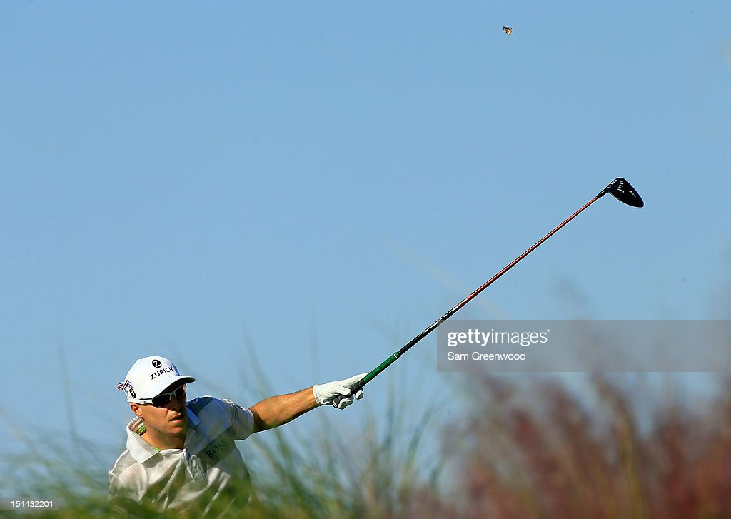 <a gi-track='captionPersonalityLinkClicked' href=/galleries/search?phrase=Ben+Crane&family=editorial&specificpeople=588003 ng-click='$event.stopPropagation()'>Ben Crane</a> watches his shot on the 13th hole during the second round of The McGladrey Classic at Sea Island's Seaside Course on October 19, 2012 in Sea Island, Georgia.
