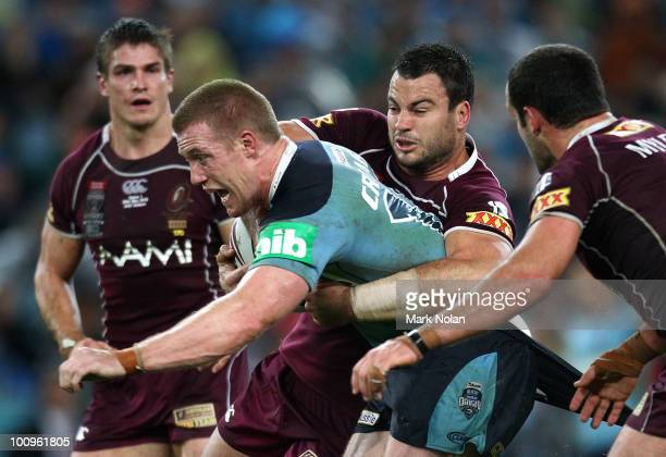 Ben Creagh of the Blues is tackled during game one of the ARL State of Origin series between the New South Wales Blues and the Queensland Maroons at...