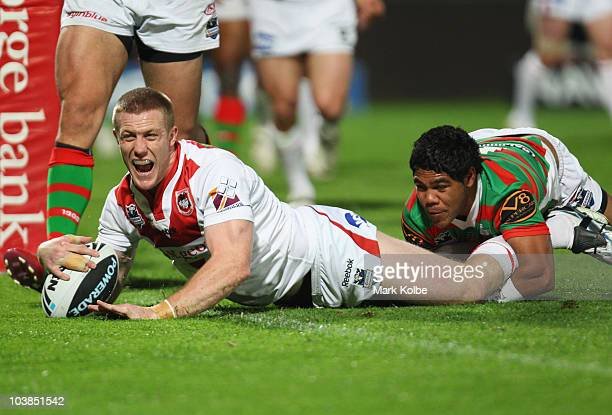Ben Creagh of the Dragons celebrates scoring a try during the round 26 NRL match between the St George Illawarra Dragons and the South Sydney...