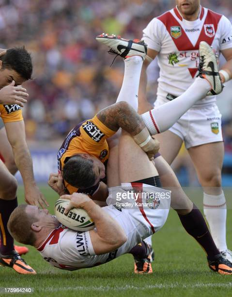 Ben Creagh of the Dragons is picked up by the defence during the round 22 NRL match between the Brisbane Broncos and the St George Illawarra Dragons...