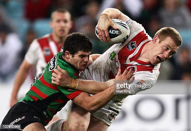 Ben Creagh of the Dragons is tackled by Beau Falloon of the Rabbitohs during the round 19 NRL match between the South Sydney Rabbitohs and the St...