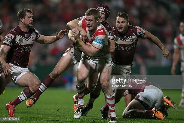Ben Creagh of the Dragons is tackled by Matt Ballin of the Sea Eagles during the round 19 NRL match between the St George Dragons and the Manly Sea...