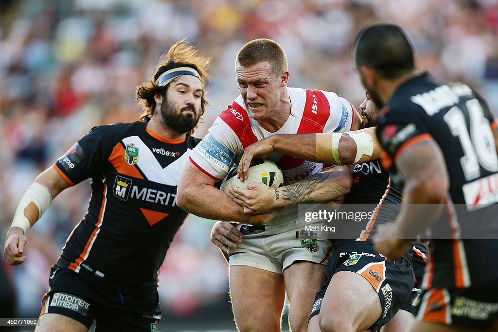 Ben Creagh of the Dragons is tackled during the round 20 NRL match between the Wests Tigers and the St George Illawarra Dragons at ANZ Stadium on July 27, 2014 in Sydney, Australia.