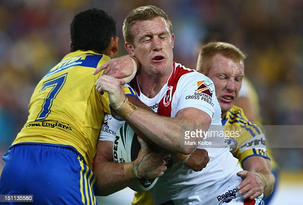 Ben Creagh of the Dragons is tackled during the round 26 NRL match between the Parramatta Eels and the St George Illawarra Dragons at ANZ Stadium on...