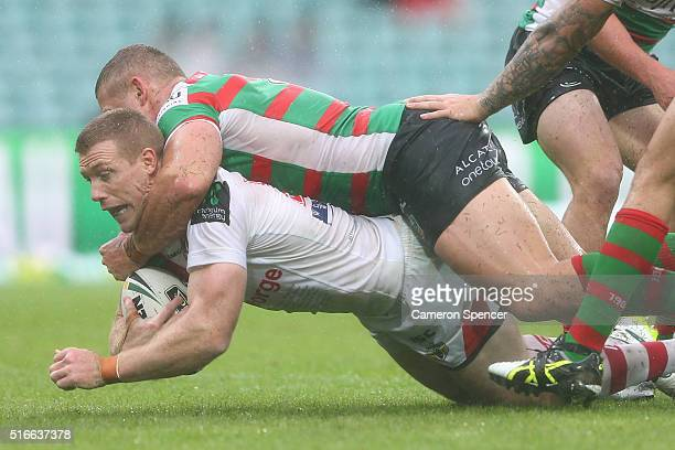 Ben Creagh of the Dragons is tackled during the round three NRL match between the St George Dragons and the South Sydney Rabbitohs at Sydney Cricket...