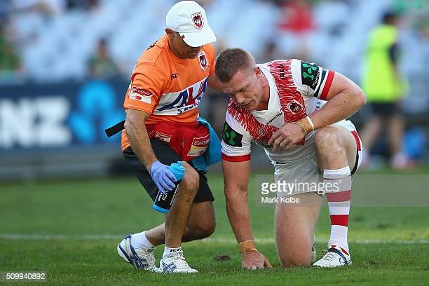 Ben Creagh of the Dragons receives attention from the trainers after making a tackle during the NRL Charity Shield match between the St George...