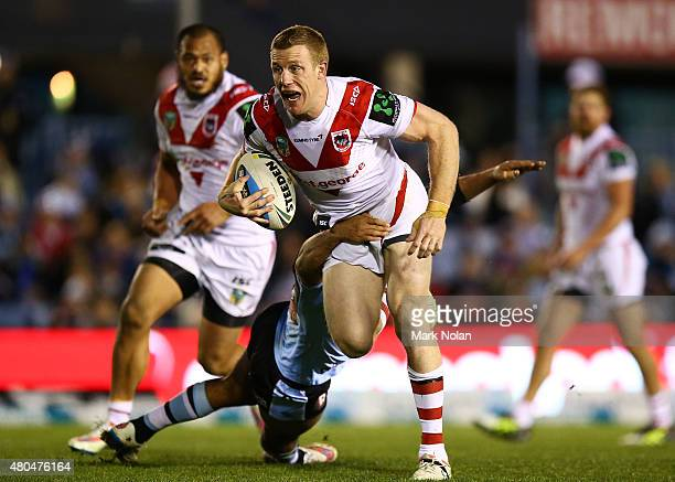 Ben Creagh of the Dragons runs the ball during the round 18 NRL match between the Cronulla Sharks and the St George Illawarra Dragons at Remondis...