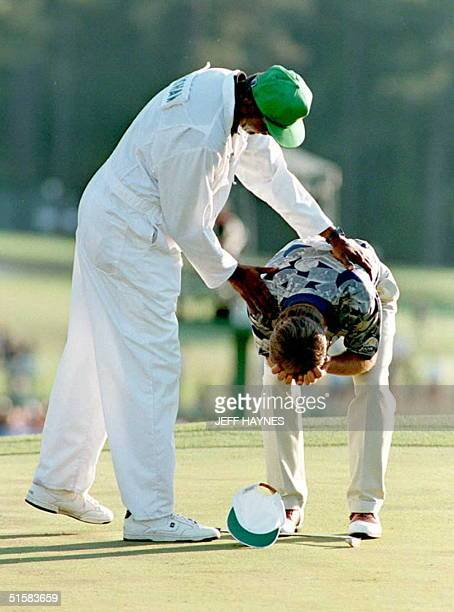Ben Crenshaw and his caddie Carl Jackson react to his winning the 1995 Masters Tournament on the eighteenth hole 09 April at the Augusta National...
