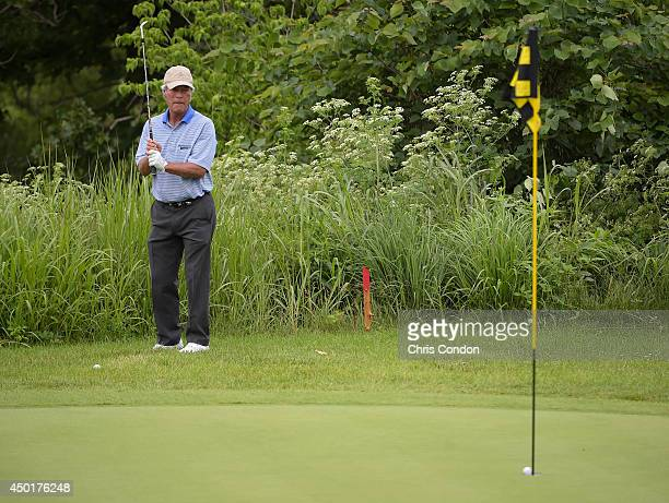 Ben Crenshaw chips in for birdie at the third green during the first round of the Big Cedar Lodge Legends of Golf presented by Bass Pro Shops at Top...
