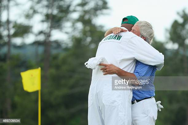 Ben Crenshaw of the United States hugs his caddie longtime Carl Jackson on the 18th green after playing his final Masters during the second round of...