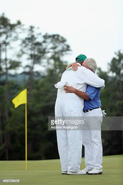 Ben Crenshaw of the United States hugs his longtime caddie Carl Jackson on the 18th green after playing his final Masters during the second round of...