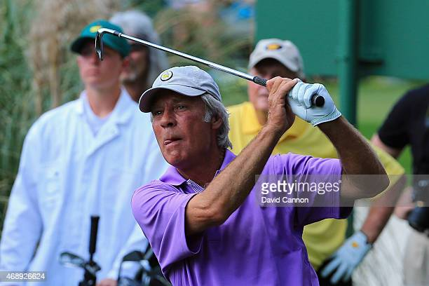 Ben Crenshaw of the United States watches a shot during the Par 3 Contest prior to the start of the 2015 Masters Tournament at Augusta National Golf...