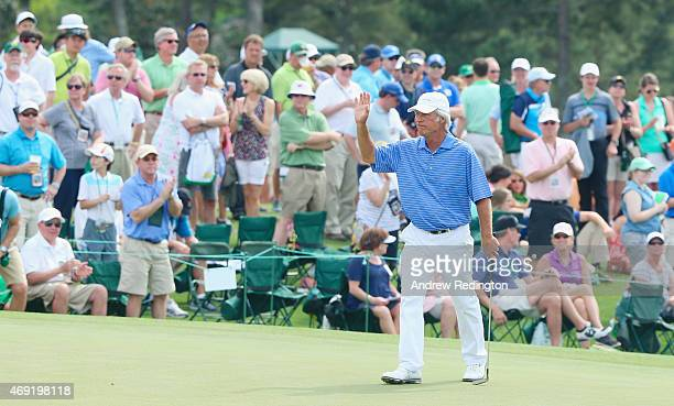 Ben Crenshaw of the United States waves to the gallery on the ninth green during the second round of the 2015 Masters Tournament at Augusta National...