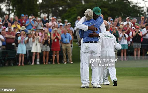 Ben Crenshaw of the US hugs caddie Carl Jackson during Round 2 of the 79th Masters Golf Tournament at Augusta National Golf Club on April 10 in...