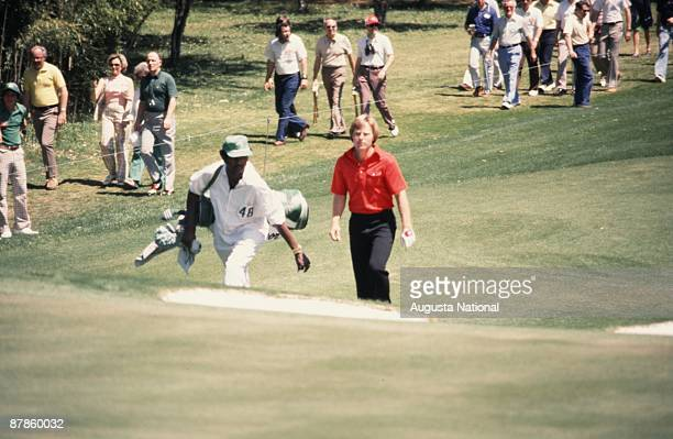 Ben Crenshaw walks up the fairway with his caddie during the 1977 Masters Tournament at Augusta National Golf Club on April 1977 in Augusta Georgia
