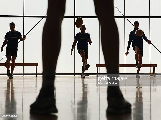Ben Cunnington kicks the ball to the legs of Ben Brown during a North Melbourne Kangaroos AFL media session at Arden Street Ground on September 15...