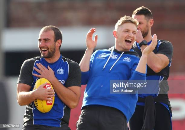 Ben Cunnington of the Kangaroos and Jack Ziebell of the Kangaroos laugh during a North Melbourne Kangaroos AFL training session at Arden Street...