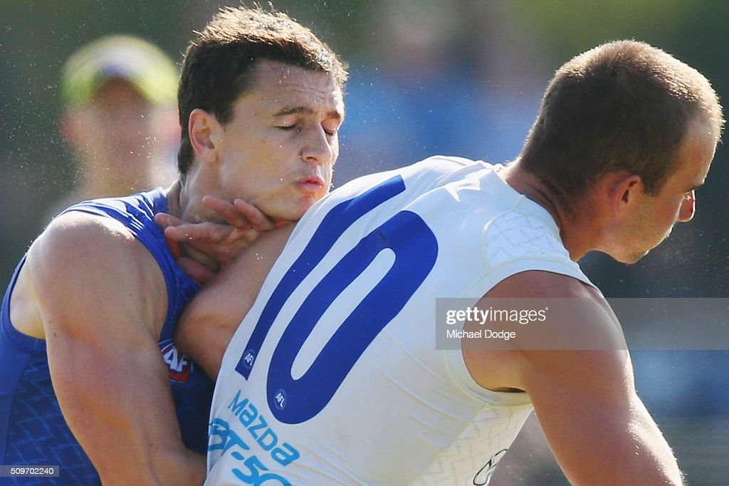 Ben Cunnington of the Kangaroos bumps Scott Thompson of the Kangaroos during the North Melbourne AFL Intra-Club match at Arden Street Ground on February 12, 2016 in Melbourne, Australia.