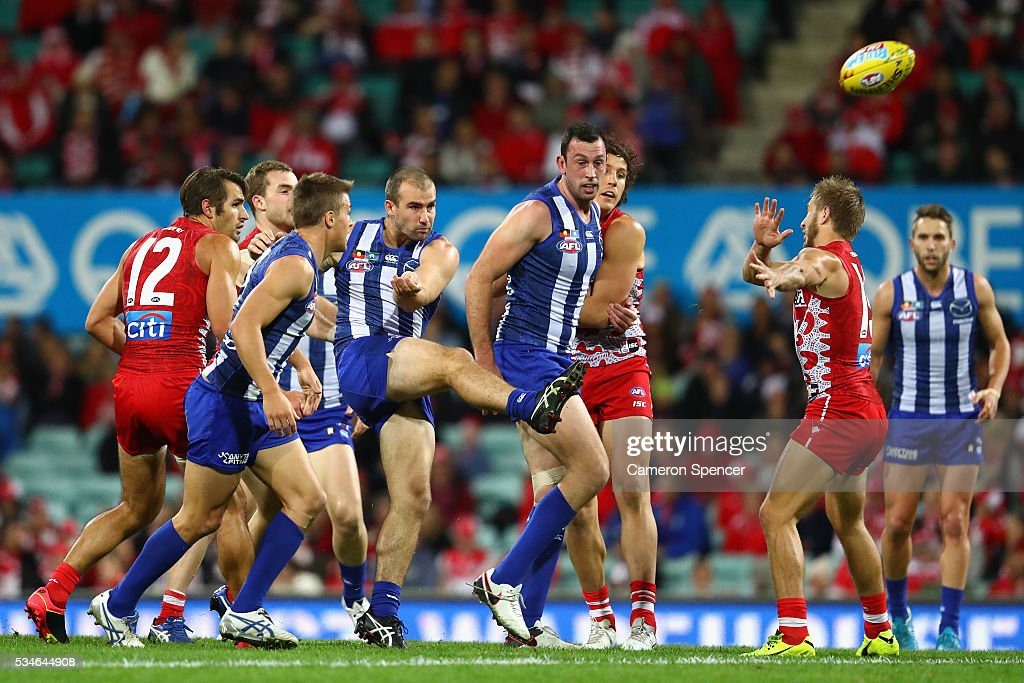 Ben Cunnington of the Kangaroos kicks the ball during the round 10 AFL match between the Sydney Swans and the North Melbourne Kangaroos at Sydney Cricket Ground on May 27, 2016 in Sydney, Australia.