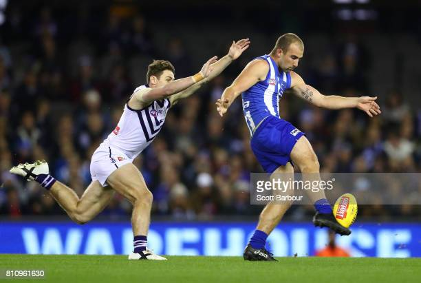 Ben Cunnington of the Kangaroos kicks the ball during the round 16 AFL match between the North Melbourne Kangaroos and the Fremantle Dockers at...