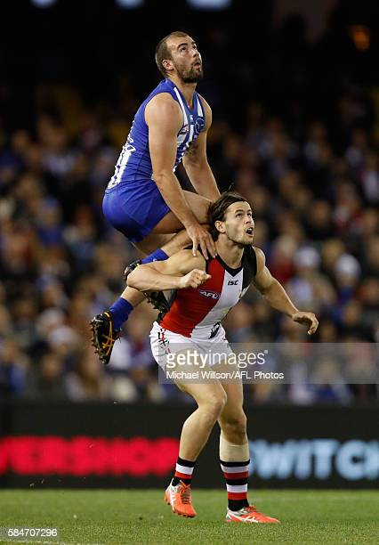 Ben Cunnington of the Kangaroos marks over Maverick Weller of the Saints during the 2016 AFL Round 19 match between the North Melbourne Kangaroos and...