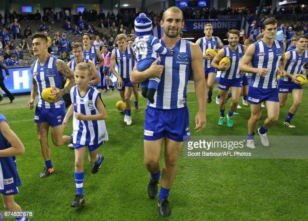 Ben Cunnington of the Kangaroos runs out for his 150th game during the round six AFL match between the North Melbourne Kangaroos and the Gold Coast...
