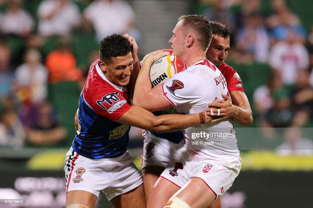 Ben Currie of England is tackled by Ilias Bergal and Nabil Djalout of France during the 2017 Rugby League World Cup match between England and France at nib Stadium on November 12, 2017 in Perth, Australia.