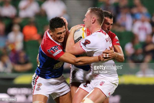 Ben Currie of England is tackled by Ilias Bergal and Nabil Djalout of France during the 2017 Rugby League World Cup match between England and France...