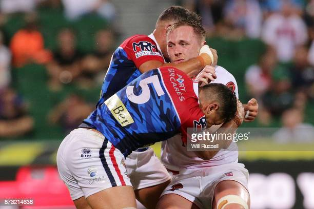 Ben Currie of England is tackled by Ilias Bergal of France during the 2017 Rugby League World Cup match between England and France at nib Stadium on...