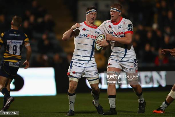 Ben Curry of Sale celebrates scoring a try alongside Matt Postlethwaite during the AngloWelsh Cup match between Worcester Warriors and Sale Sharks at...