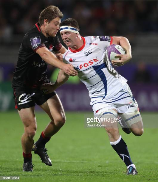 Ben Curry of Sale is held by Theo Belan during the European Rugby Challenge Cup match between Lyon and Sale Sharks at Matmut Stade de Gerland on...