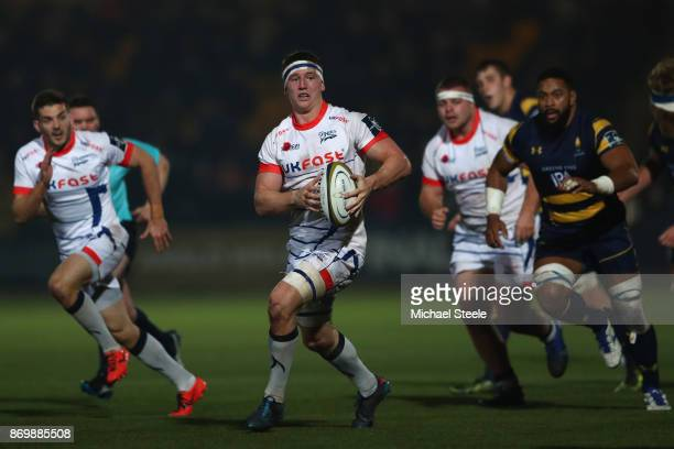 Ben Curry of Sale makes a break as Christian ScotlandWilliamson of Worcester looks on during the AngloWelsh Cup match between Worcester Warriors and...