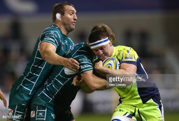 Ben Curry of Sale Sharks is tackled by Mike Coman of London Irish during the Aviva Premiership match between Sale Sharks and London Irish at AJ Bell...