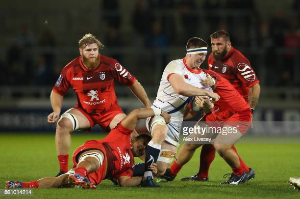 Ben Curry of Sale Sharks is tackled by Selevasio Tolofua of Toulouse during the European Rugby Challenge Cup match between Sale Sharks and Toulouse...