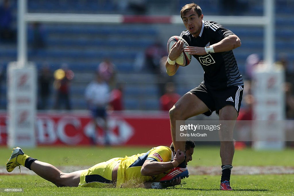 <a gi-track='captionPersonalityLinkClicked' href=/galleries/search?phrase=Ben+Curtis&family=editorial&specificpeople=209103 ng-click='$event.stopPropagation()'>Ben Curtis</a> #11 of New Zealand breaks a tackle against Australia during the Tokyo Sevens, in the six round of the HSBC Sevens World Series at the Prince Chichibu Memorial Ground on March 23, 2014 in Tokyo, Japan.