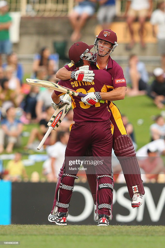 Ben Cutting and Chris Lynn of the Bulls celebrate victory during the Ryobi Cup Final match between the Queensland Bulls and the New South Wales Blues at North Sydney Oval on October 27, 2013 in Sydney, Australia.