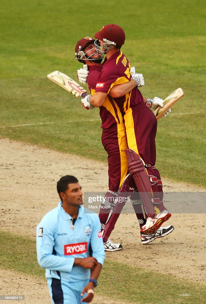 Ben Cutting and Chris Lynn of the Bulls celebrate winning the Ryobi Cup Final match between the Queensland Bulls and the New South Wales Blues at North Sydney Oval on October 27, 2013 in Sydney, Australia.