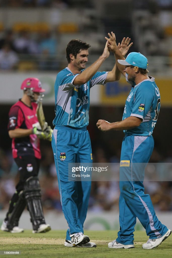 Ben Cutting and Peter Forrest of the Heat celebrate dismissing Steven Smith of the Sixers during the Big Bash League match between the Brisbane Heat and the Sydney Sixers at The Gabba on January 7, 2013 in Brisbane, Australia.