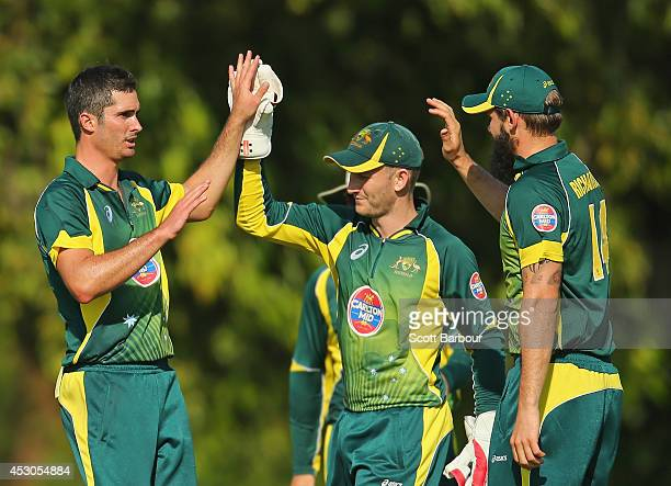 Ben Cutting of Australia 'A' is congratulated by Peter Nevill and Kane Richardson after dismissing Manoj Tiwary of India 'A' during the Cricket...