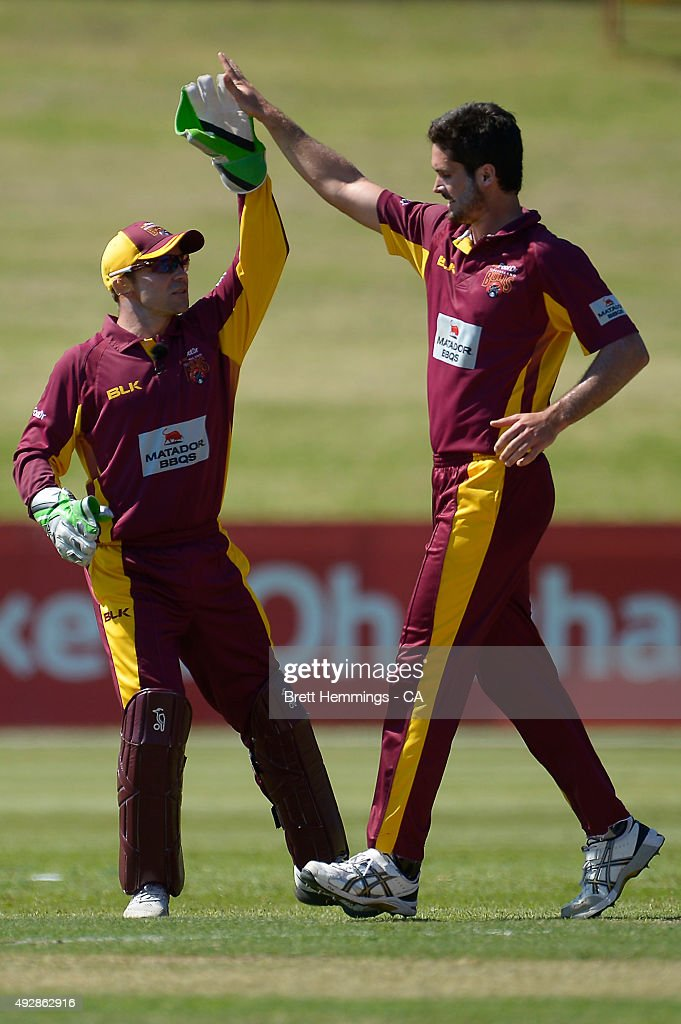 <a gi-track='captionPersonalityLinkClicked' href=/galleries/search?phrase=Ben+Cutting&family=editorial&specificpeople=4537947 ng-click='$event.stopPropagation()'>Ben Cutting</a> of Queensland celebrates after taking the wicket of Ed Cowan of NSW during the Matador BBQs One Day Cup match between Queensland and New South Wales at Drummoyne Oval on October 16, 2015 in Sydney, Australia.