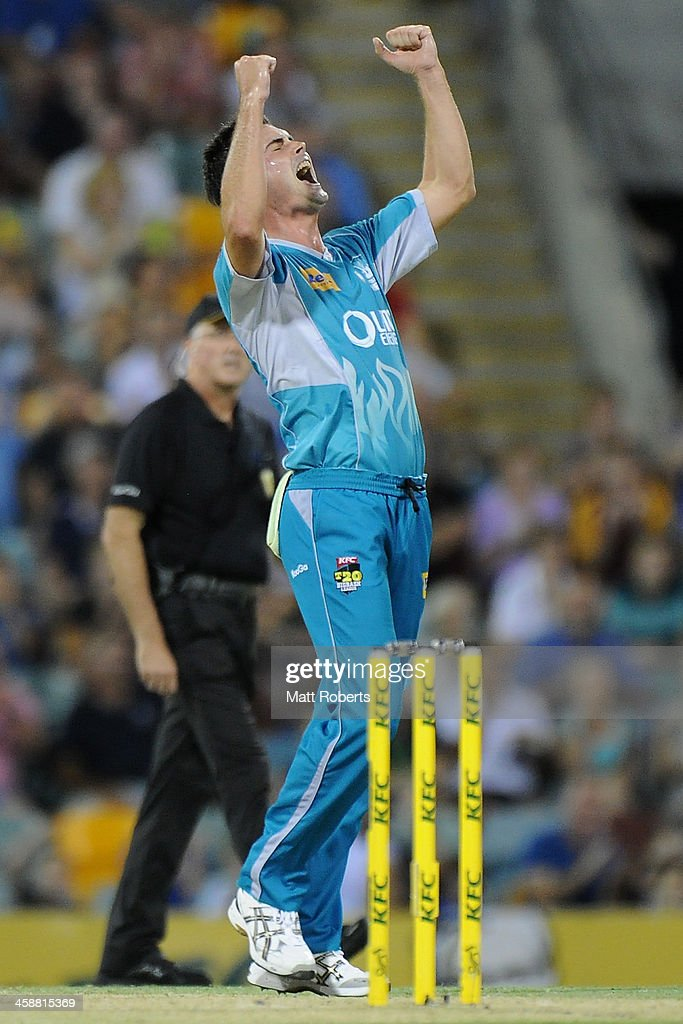 Ben Cutting of the Heat celebrates a wicket during the Big Bash League match between the Brisbane Heat and the Perth Scorchers at The Gabba on December 22, 2013 in Brisbane, Australia.