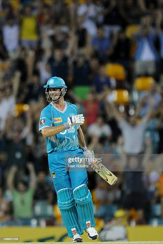 Ben Cutting of the Heat celebrates winning the Big Bash League match between the Brisbane Heat and the Perth Scorchers at The Gabba on December 22, 2013 in Brisbane, Australia.