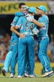 Ben Cutting of the Heat celebrates with team mate Dan Christian after combining to dismiss Shaun Marsh of the Scorchers during the Big Bash League...