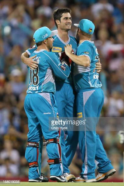 Ben Cutting of the Heat celebrates with team mates after dismissing Jon Wells of the Hurricanes during the Big Bash League match between the Brisbane...