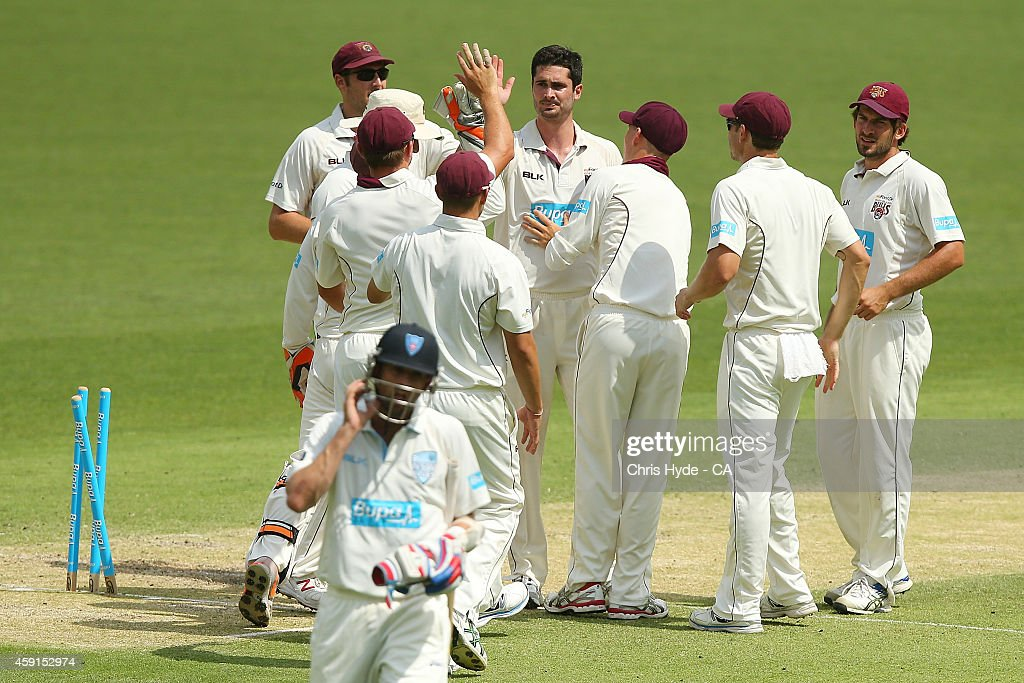 <a gi-track='captionPersonalityLinkClicked' href=/galleries/search?phrase=Ben+Cutting&family=editorial&specificpeople=4537947 ng-click='$event.stopPropagation()'>Ben Cutting</a> of the the Bulls celebrates with team mates after dismissing Nathan Lyon of the Blues during day three of the Sheffield Shield match between Queensland Bulls and New South Wales Blues at The Gabba on November 18, 2014 in Brisbane, Australia.