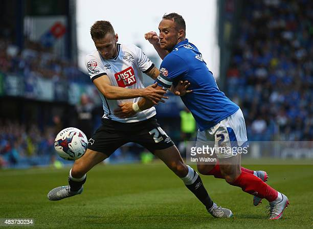 Ben Davies of Portsmouth is tackled by Andreas Weimann of Derby County during the Capital One Cup First Round match between Portsmouth v Derby County...